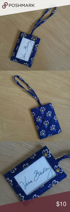 """Vera Bradley Blue Floral Luggage Tag Vera Bradley Blue Floral Luggage Tag. Item is pre owned, was used once for a trip. No rips or stains. Item comes from smoke free home. Lenght: 3"""" Height: 4"""" Handle: 5"""" Vera Bradley Bags Clutches & Wristlets"""
