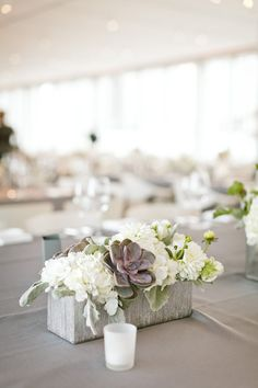 idea- concrete blocks as flower centerpiece planters?
