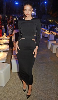 Barbara Palvin in a body-hugging cutout black sheath with cutout heels to match at the de Grisogono party.