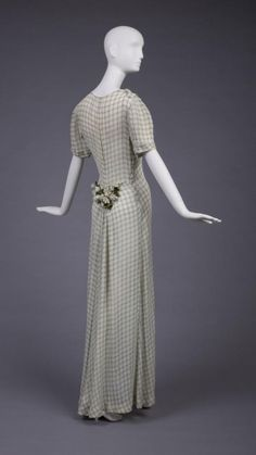 Dress that shows that she could do sweet and romantic, too...   Elsa Schiaparelli, 1935