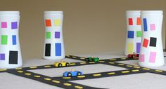 Recycled city! Imaginative play with foam roads and buildings made out of recycled containers.