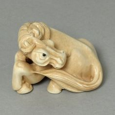 """Handcrafted Mammoth Ivory netsuke Zodiac Horse Carving size: 1-3/4"""" x 15/16"""" x 1-1/16"""" (45mm x 24mm x 27mm)."""