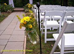 Wedding aisle lined in sunny yellow florals.