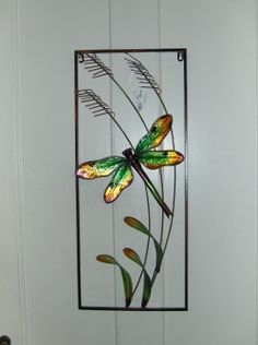 Metal wall art in various colors and styles makes an attractive alternative to framed prints in the home or office.