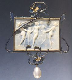 Lalique Dancing Nymphs (pendant), artificial ivory, enamel, gold and a pearl