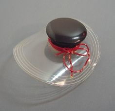 Bakelite and Lucite black and clear hat brooch.    One day I will own a Bakelite hat pin.