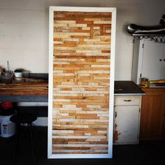 Reclaimed wood lathing that was buried under plaster in 1924 is now an easy to make focal piece of art.