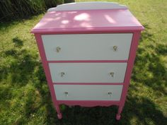 the after look . chest of drawers..finally work on it today ..painted in a 2 tone ..bubble gum pink & white ... & new knobs