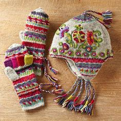 Kamala Stripes Kamala Convertible Mittens. Women in Kathmandu, Nepal, knit these unconventional, colorful winter mittens from pure wool. A single artisan is responsible for the item from start to finish, from casting on the first stitch to the hand-embroidered accents. The mitten flap can be folded over and secured with a coconut-wood button to leave fingers free, or folded over for warmth while still leaving a small exposed hole in the thumb open to enable texting or typing on a cell phone.