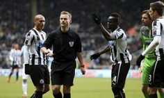 Referee Mike Jones feels the wrath of Newcastle United's players after disallowing Cheik Tioté's strike against Manchester City.