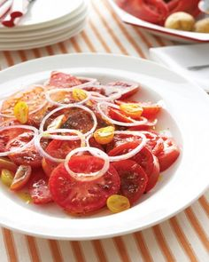 Sliced Tomatoes and Red Onion - In late summer, savor the perfect simplicity of a salad with ripe tomatoes from the garden and a few slices of onion.