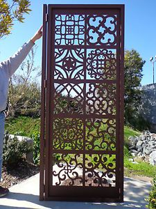 "Metal garden gate - probably laser cut, sampler with many patterns - 36"" x 6' - 12 gauge stell - baked on zinc primer and textured rust powder coating - Davinci Gate"