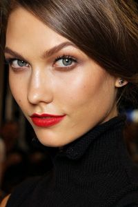 For the bride who's drawn to vintage beauty, the perfectly matte red lips and strong brows here evoke classic Old Hollywood.