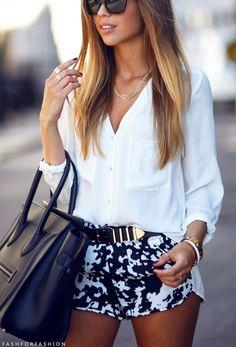 Black and white shorts, white top with black handbag