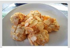 Greek Almond Macaroon (amygdalota) why have I never heard of these before? I'd like to test drive this one with some alternative sweetners. Greek Sweets, Greek Desserts, Greek Recipes, Greek Cookies, Almond Meal Cookies, Dessert Recipes, Gourmet Recipes, Cooking Recipes, Biscuits