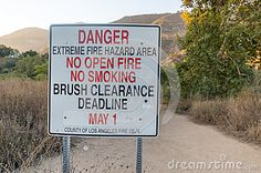 Sign warning of no smoking or open fires in extreme wildfire area in Eaton Canyon in Los Angeles County. The park is in the front country of the San Gabriel Mountains above the community of Altadena.