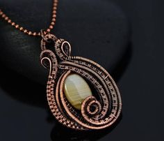 Elegant handmade banded agate necklace. Very chic and unique! This unique heart pendant is lovingly made from many meters of pure copper wire layered to emphasize the texture and depth of the design. It is full of elaborate fine details and textures. It will arrive to you nicely packed