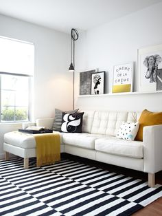 scandinavian living room white sofa with black & white throw pillows white & black stripes area rug single shelf in white wall ornaments of Be Simple yet Modern with These Black and White Living Room Sets Home Living Room, Living Room Designs, Living Room Decor, Apartment Living, Living Spaces, Apartment Furniture, Decor Room, Room Art, Bedroom Apartment