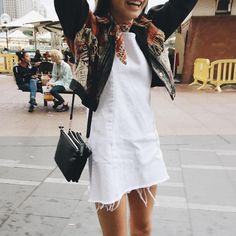 white t-shirt dress, black leather jacket, vintage scarf or red pattern scarf, black cross-body bag, hair out, black heel boots