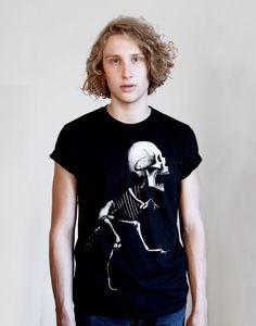 TYRANNHUMANUS REX TEEE. Black t-shirt with white print in unisex style. Design by Razi Kantorp.