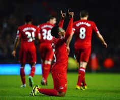 Sturridge thanks the man above after he makes it 3-0 to Liverpool. #LFC #derbyday