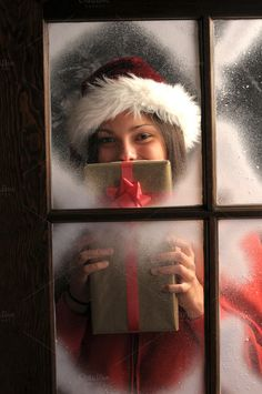 Check out Girl in Window with Christmas Gift by Steve Cukrov Photography on Creative Market