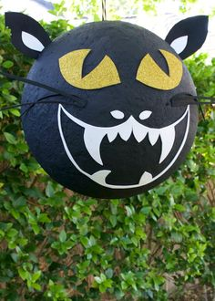 Thought your only pinata options were the ones hanging in the party store, you were wrong. Learn how to make your own DIY black cat pinata this Halloween.