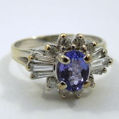 0.50 Carat Oval Cut Tanzanite set in 14k White Gold and Surrounded by Diamonds. $820