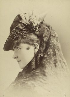 A strikingly gorgeous Victorian woman, identified only as Miss Arlington. Not only is this lady herself lovely, but the portrait is lovely.