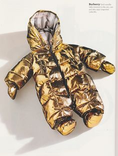 Burberry's metallic gold baby snowsuit...so space-age!