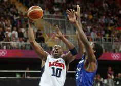 Kobe Bryant (L) of the U.S. shoot past France's Mickael Gelabale during their men's Group A basketball match at the London 2012 Olympic Games in the Basketball arena  July 29, 2012