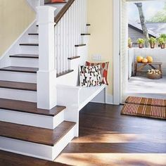 Setting the banister back and kicking the stairs out creates nice little nook for seating & will open the main room to the stairway.
