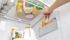 Buy bathroom suction baskets and use in fridge! Why do I not think of these things!