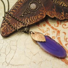 Beautiful purple agate necklace made of raw agate slice stone and polymer clay leaf decorated with copper metallic powder. DANA BROSH special design,