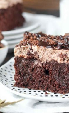 Brownie batter poke cake is a chocolate lover's dream! This decadent treat is easy to make, and is such a crowd pleaser.