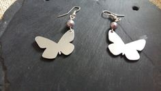 Aluminium Butterfly earrings with lavender Swarovski Pearls, finished on Sterling silver fish hook ear wires. These beautiful dangle and drop earrings are light weight to wear, making them perfect for everyday use. The Butterfly measures at its wi. Butterfly Earrings, Swarovski Pearls, Color Change, Dangle Earrings, Gifts For Her, Dangles, Gift Wrapping, Sterling Silver, Unique Jewelry