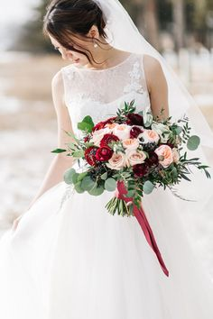 Love this photo of our March bride @bvrrestaurant with her oversized bridal bouquet of Juliet garden roses, anemones, ranunculus and privet berries! The perfect winter wedding flower combination for a Calgary wedding! Photo: http://stephaniecouture.ca/ Bouquet: www.flowersbyjanie.com