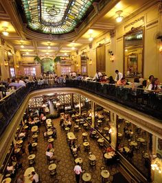 Inspired by the grand European cafés, Confeitaria Colombo was the place to be in Rio at the turn of the 20th century. It hosted fancy balls and cultural events, and was the site of much gossip during the afternoon teas of the city's upper-class. Its huge stained glass, tiled, and mirrored interior features materials from France, Portugal, and Belgium, all creating an opulent art nouveau space for classic Brazilian cuisine, delicious pastries, a cup of tea or the famous Brazilian coffee.