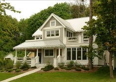 Exterior Paint Color Benjamin Moore Revere Pewter HC-172. Trims are Benjamin Moore Linen White 912.