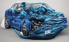 That is not a wrecked car...it is 17 people painted to look like a wrecked car. COOL!