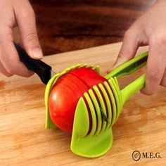 Easy to use Food Tomato Onion Vegetable Fruit Slicer Egg Peel Cutter Holder Clip. Add the tomato slicer along each gap from the top down the you could cut it into pieces. Just cut to the vegetables or fruits in the slicer, can cut out up to Home Gadgets, Kitchen Tools And Gadgets, Cooking Gadgets, Cooking Tools, Kitchen Hacks, Cooking Equipment, Useful Gadgets, Cooking Fish, Travel Gadgets