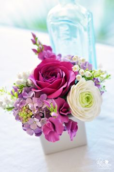 Clay Flowers; ranunculus, rose, lily of the valley, hyacinth, sweet peas and hydrangeas.