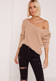 Slay in this totally laid back off the shoulder sweater in pink.