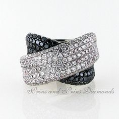 There are 88 = round black diamonds and 185 = GH/VS – SI round brilliant cut diamonds pavé set in a chunky white gold crossover ring Crossover Ring, White Gold, Black And White, Black Diamonds, Dress Rings, Classy, Fancy, Colours, Accessories