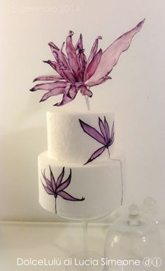 Manipulating wafer paper for modern flowers See more cake decorating ideas at www.acaketoremember.com wafer paper ideas