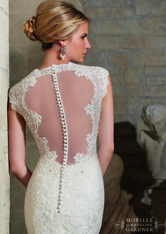 """It also has an amazing sheer low back with lace """"frame"""" and covered button detail."""