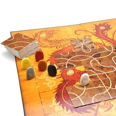 The object of Tsuro is to place tiles in a square adjacent to your stone playing piece in order to build a safe path for your stone's journey while trying to work your opponents' stones off the board.