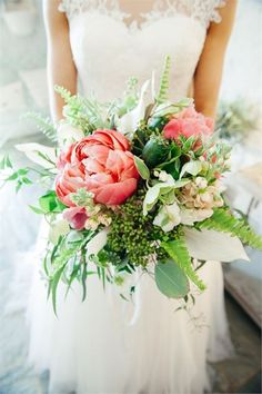 This rustic bouquet has a gorgeous mix of flowers and foliage - we especially love the pink accents. Image by Dan Rayner Photography
