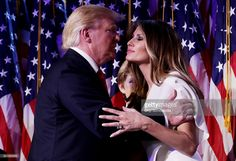 Republican president-elect Donald Trump embraces his wife Melania Trump during his election night event at the New York Hilton Midtown in the early morning hours of November 9, 2016 in New York City. Donald Trump defeated Democratic presidential nominee Hillary Clinton to become the 45th president of the United States.