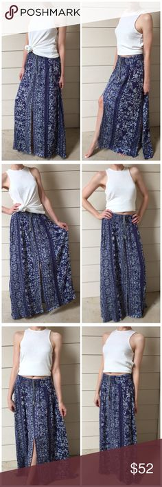 "▫Blue Boho Floral Printed Maxi Skirt Nothing screams Boho Summer like comfy Maxi skirts! This one is amazing!! Blue floral patterned shirt with comfy soft and VERY stretchy smocked waist. Non-functional tassel tie in front and three slots on legs (one on each side and one in the middle). So flowy when you walk and pairs perfectly with any white or grey tee or tank! ❤ I'm obsessed-just beautifully made! Modeling small. I am 5'4"". Can be worn high or low waist, depending on your height! 50%…"
